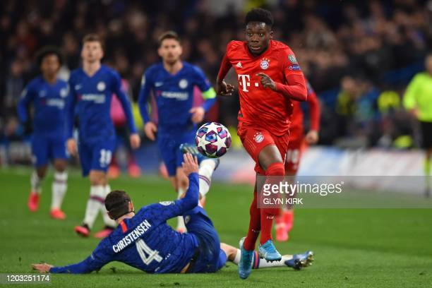 Bayern Munich's Canadian midfielder Alphonso Davies evades the challenge from Chelsea's Danish defender Andreas Christensen on his way to setting up...