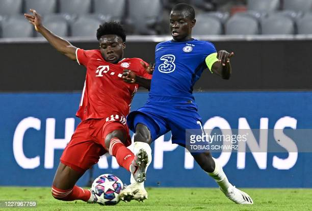 Bayern Munich's Canadian midfielder Alphonso Davies fights for the ball with Chelsea's French midfielder N'Golo Kante during the UEFA Champions...