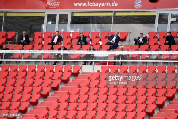 Bayern Munich's CEO Karl-Heinz Rummenigge, President Herbert Hainer and former president Uli Hoeness and representatives of the club sit in the empty...