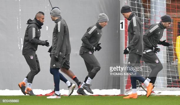 Bayern Munich's Chilean midfielder Arturo Vidal Bayern Munich's Polish forward Robert Lewandowski Bayern Munich's forward Sandro Wagner and Bayern...
