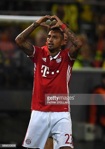 Bayern Munich's Chilean midfielder Arturo Vidal celebrates during the German Super Cup football match final Borussia Dortmund vs FC Bayern Munich in...