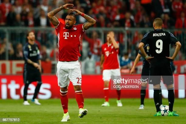 Bayern Munich's Chilean midfielder Arturo Vidal celebrates scoring the opening goal during the UEFA Champions League 1st leg quarterfinal football...
