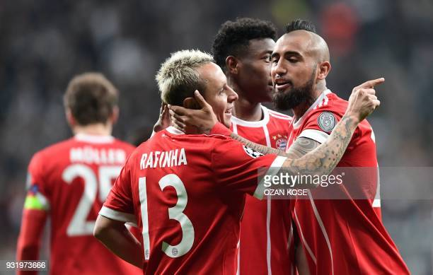 Bayern Munich's Chilean midfielder Arturo Vidal celebrates with teammate Bayern Munich's Brazilian defender Rafinha after Besiktas scored an own goal...