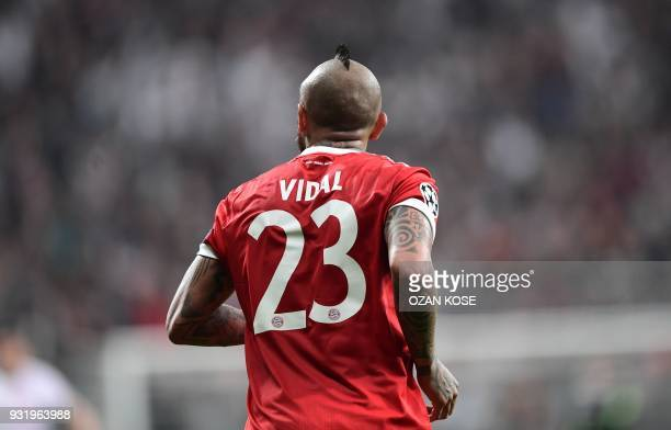 Bayern Munich's Chilean midfielder Arturo Vidal runs on the pitch during the second leg of the last 16 UEFA Champions League football match between...