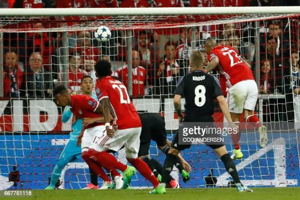 Bayern Munich's Chilean midfielder Arturo Vidal scores the opening goal during the UEFA Champions League 1st leg quarterfinal football match FC...