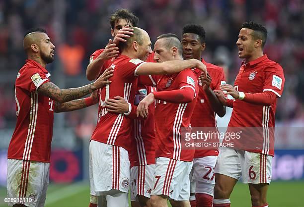 Bayern Munich's Chilian midfielder Arturo Vidal Bayern Munich's Spanish midfielder Javi Martinez Bayern Munich's Dutch midfielder Arjen Robben Bayern...