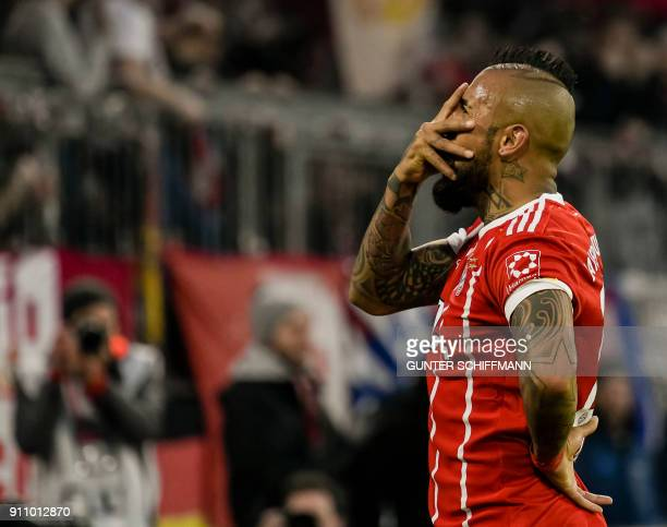 Bayern Munich's Chilian midfielder Arturo Vidal celebrates after scoring during the German first division Bundesliga football match Bayern Munich v...