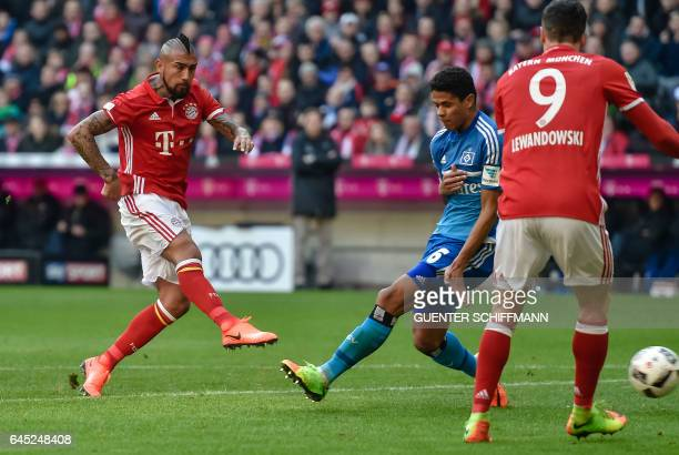 Bayern Munich's Chilian midfielder Arturo Vidal scores the first goal during the German first division Bundesliga football match between Bayern...