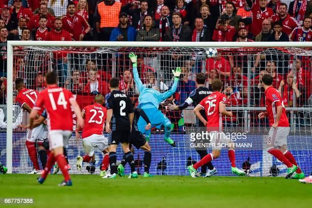 TOPSHOT Bayern Munich's Chilian midfielder Arturo Vidal scores the first goal during the UEFA Champions League 1st leg quarterfinal football match FC...