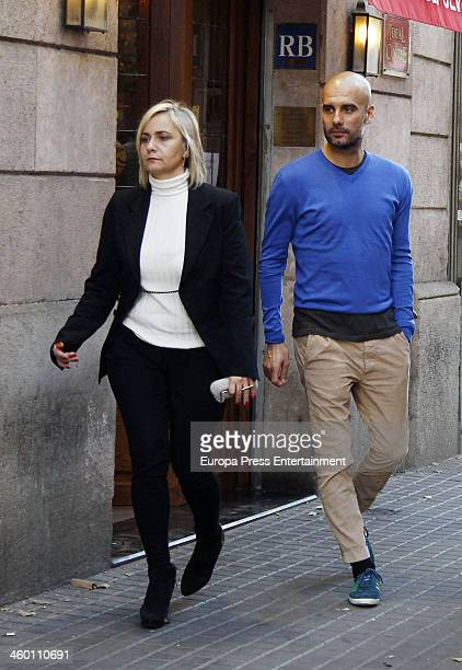 Bayern Munich's coach Pep Guardiola and family are seen on December 23 2013 in Barcelona Spain