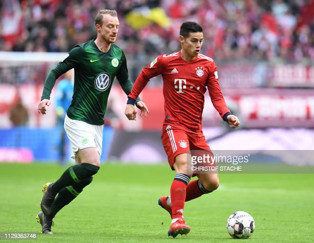 Bayern Munich's Colombian James Rodriguez and Wolfsburg's midfielder Maximilian Arnold vie for the ball during the German first division Bundesliga...