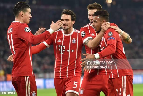 Bayern Munich's Colombian James Rodriguez Bayern Munich's defender Mats Hummels Bayern Munich's defender Niklas Suele and Bayern Munich's French...