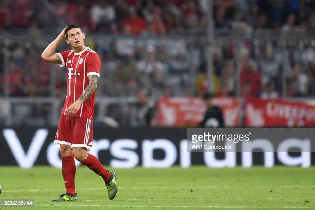 Bayern Munich's Colombian James Rodriguez leaves the pitch during the break of the second Audi Cup football match between FC Bayern Munich and FC...