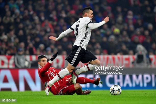 Bayern Munich's Colombian midfielder James Rodriguez and Besiktas' Portuguese defender Pepe vie with the ball during the UEFA Champions League round...