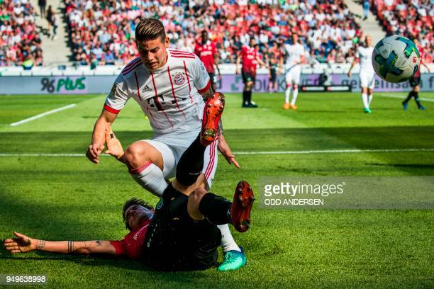 Bayern Munich's Colombian midfielder James Rodriguez and Hanover's German defender Oliver Sorg vie for the ball during the German first division...