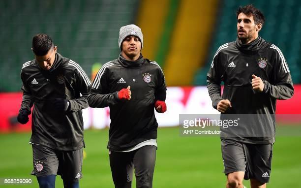 Bayern Munich's Colombian midfielder James Rodriguez Bayern Munich's Spanish midfielder Thiago Alcantara and Bayern Munich's Spanish midfielder...