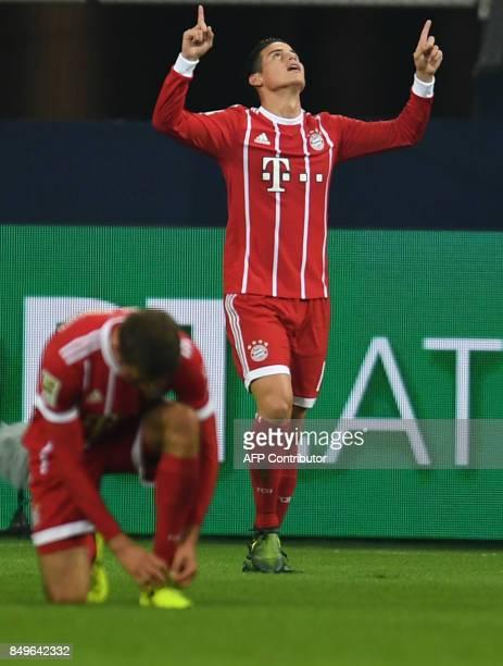 Bayern Munich's Colombian midfielder James Rodriguez celebrates during the German First division Bundesliga football match between FC Schalke 04 and...