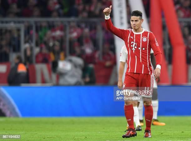 Bayern Munich's Colombian midfielder James Rodriguez gestures after scoring during the German First division Bundesliga football match Bayern Munich...