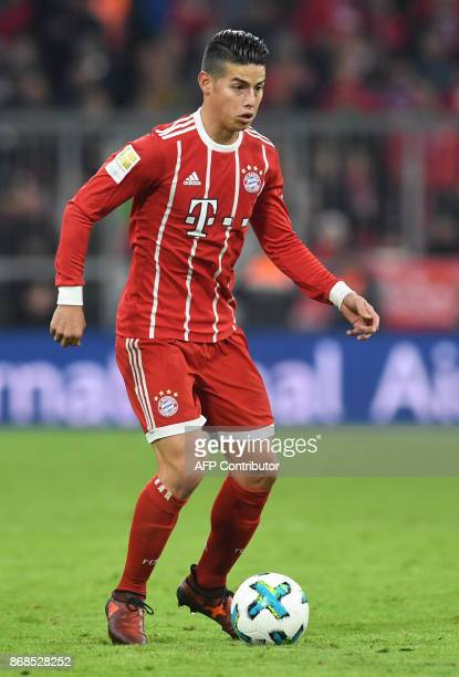 Bayern Munich's Colombian midfielder James Rodriguez plays the ball during the German first division Bundesliga football match Bayern Munich vs RB...