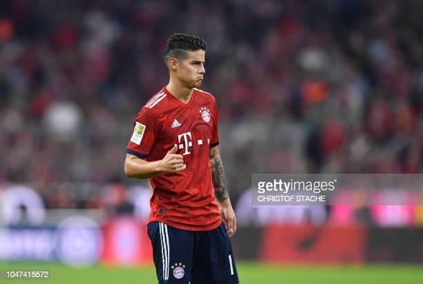 Bayern Munich's Colombian midfielder James Rodriguez reacts during the German first division Bundesliga football match FC Bayern Munich vs Borussia...