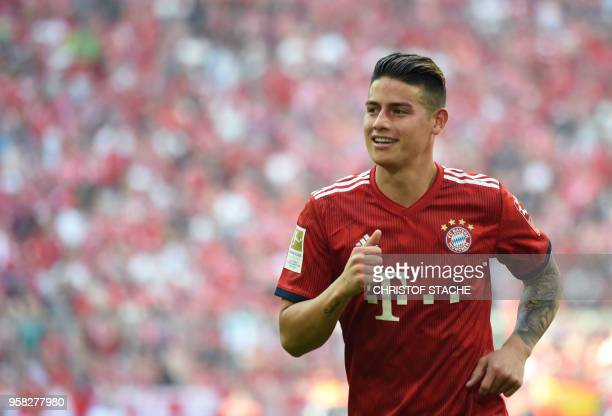 Bayern Munich's Colombian midfielder James Rodriguez runs during the German first division Bundesliga football match FC Bayern Munich and VfB...