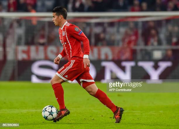 Bayern Munich's Colombian midfielder James Rodriguez runs with the ball during the Champions League group B match between FC Bayern Munich and Celtic...