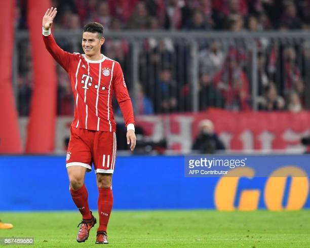 Bayern Munich's Colombian midfielder James Rodriguez waves after scoring during the German First division Bundesliga football match Bayern Munich vs...