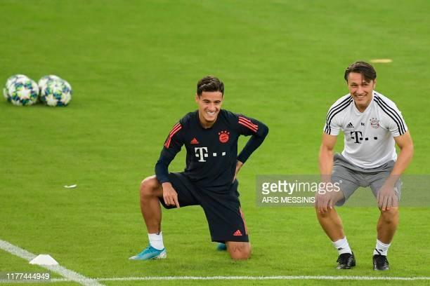 Bayern Munich's Croatian head coach Niko Kovac and Bayern Munich's Brazilian midfielder Philippe Coutinho attend a training session at the Karaiskaki...