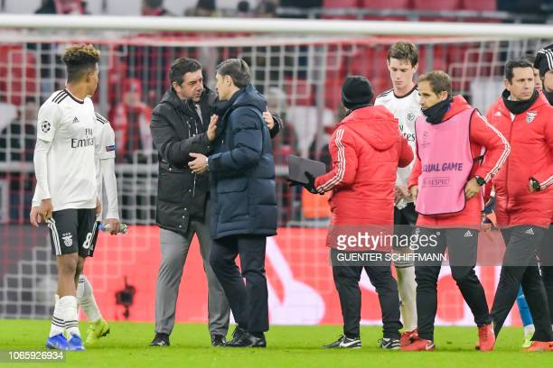 Bayern Munich's Croatian headcoach Niko Kovac and Benfica's Portuguese coach Rui Vitoria talk after the UEFA Champions League Group E football match...