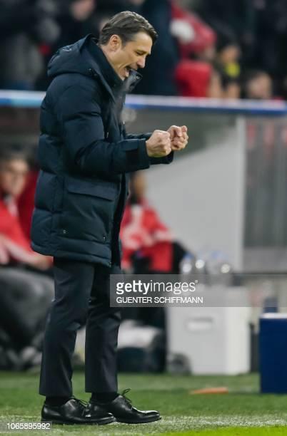 Bayern Munich's Croatian headcoach Niko Kovac celebrates the opening goal during the UEFA Champions League Group E football match Bayern Munich vs...