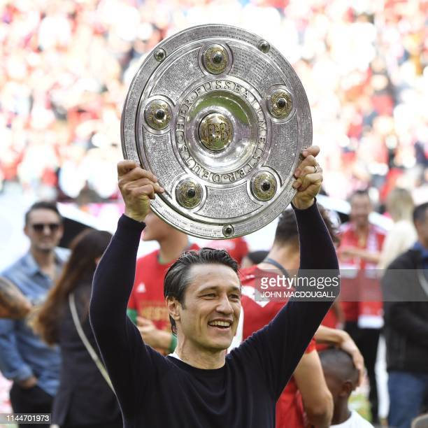 Bayern Munich's Croatian headcoach Niko Kovac celebrates with the trophy after the German First division Bundesliga football match FC Bayern Munich v...
