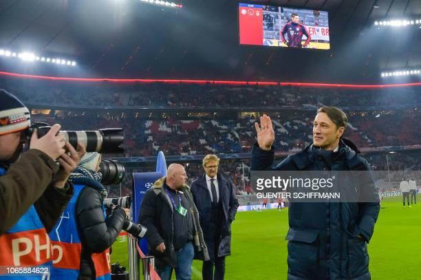 Bayern Munich's Croatian headcoach Niko Kovac waves as he arrives prior to the UEFA Champions League Group E football match Bayern Munich vs Benfica...