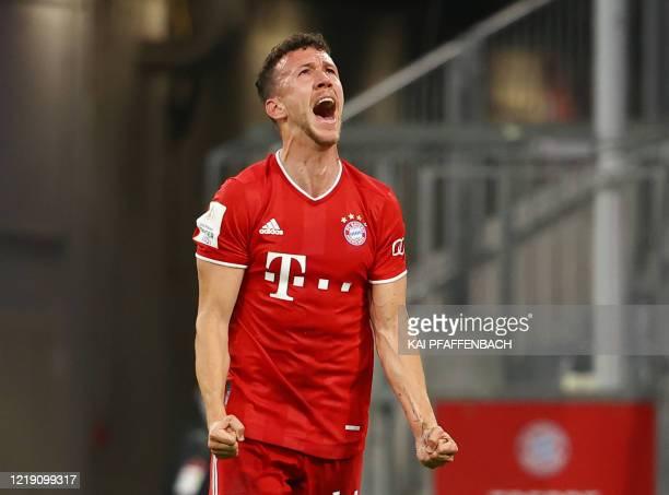 Bayern Munich's Croatian midfielder Ivan Perisic celebrates scoring the opening goal during the German Cup semi-final football match FC Bayern Munich...