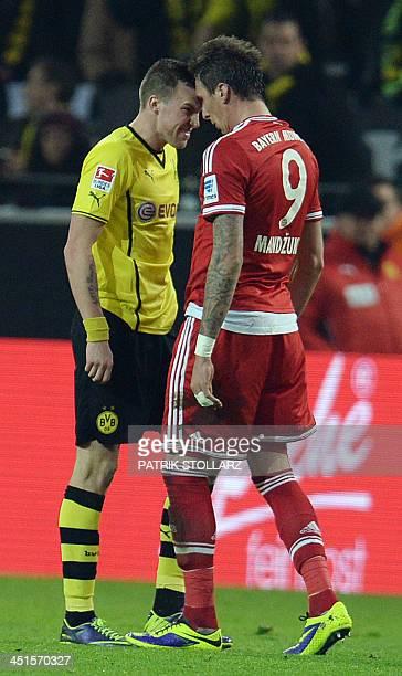 Bayern Munich's Croatian striker Mario Mandzukic and Dortmund's midfielder Kevin Grosskreutz clash during the German first division Bundesliga...