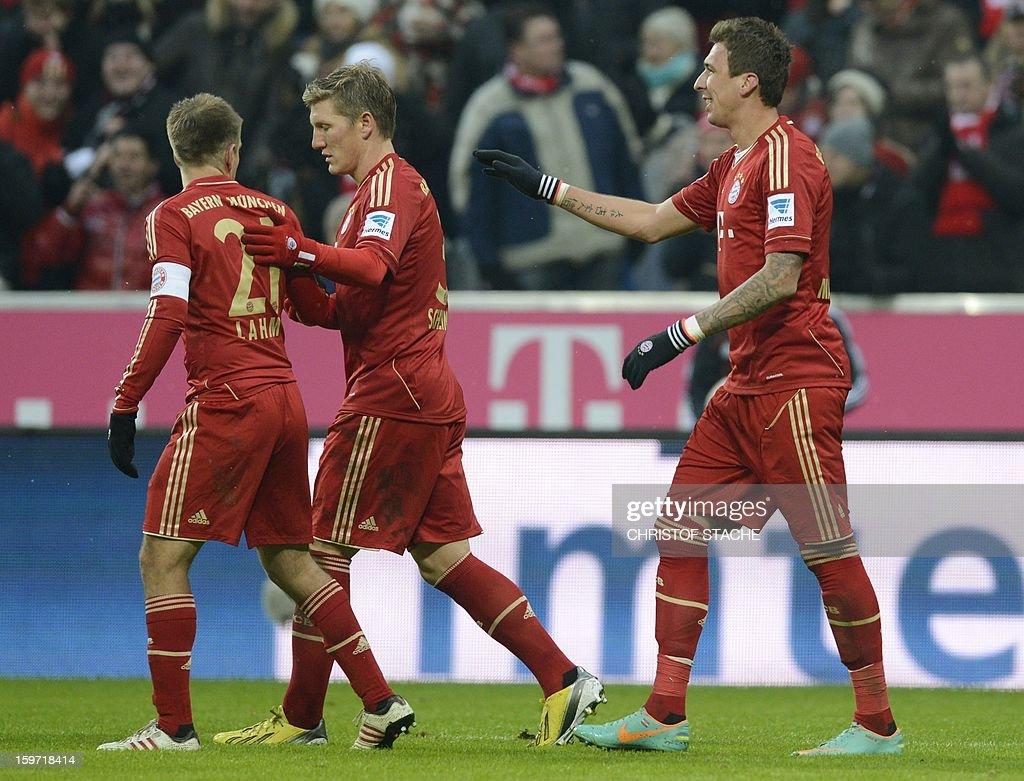Bayern Munich's Croatian striker Mario Mandzukic, Bayern Munich's midfielder Bastian Schweinsteiger and Bayern Munich's defender Philipp Lahm (R-L) react after the second goal during the German first division Bundesliga football match FC Bayern Munich vs Greuther Fuerth in Munich, southern Germany, on January 19, 2013.