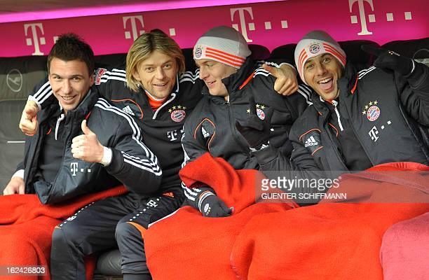 Bayern Munich's Croation striker Mario Mandzukic Bayern Munich's Ukrainian midfielder Anatoliy Tymoshchuk Bayern Munich's German midfielder Toni...