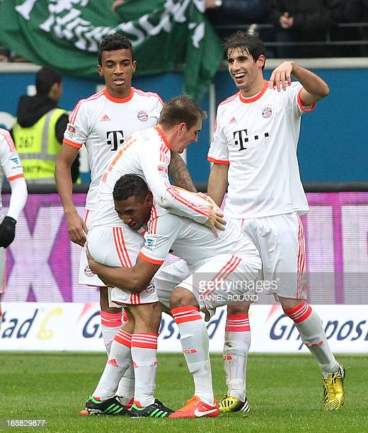 FC Bayern Munich's David Alaba and Jerome Boateng celebrate with teammates the 10 victory after the German first division Bundesliga football match...