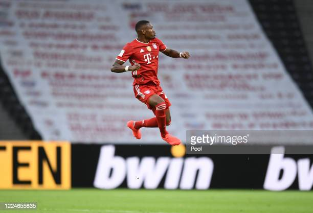 Bayern Munich's David Alaba celebrates scoring their first goal during the DFB Cup final match between Bayer 04 Leverkusen and FC Bayern Muenchen at...