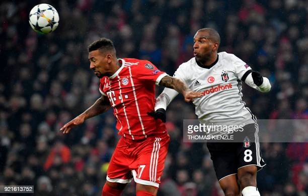 Bayern Munich's defender Jerome Boateng and Besiktas' Dutch midfielder Ryan Babel vie for the ball during the UEFA Champions League round of sixteen...