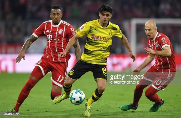 Bayern Munich's defender Jerome Boateng Dortmund's German midfielder Mahmoud Dahoud and Bayern Munich's Dutch midfielder Arjen Robben vie for the...