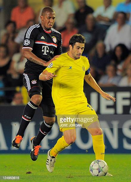 Bayern Munich's defender Jerome Boateng vies with Villarreal's midfielder Cani during the UEFA Champions League football match between Villarreal and...