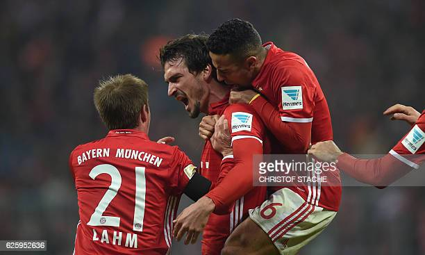 Bayern Munich's defender Mats Hummels celebrates scoring with his teammates during the German first division Bundesliga football match between FC...