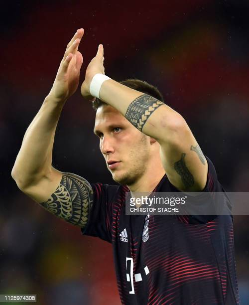 Bayern Munich's defender Niklas Suele arrives prior the UEFA Champions League round of 16 first leg football match between Liverpool and Bayern...