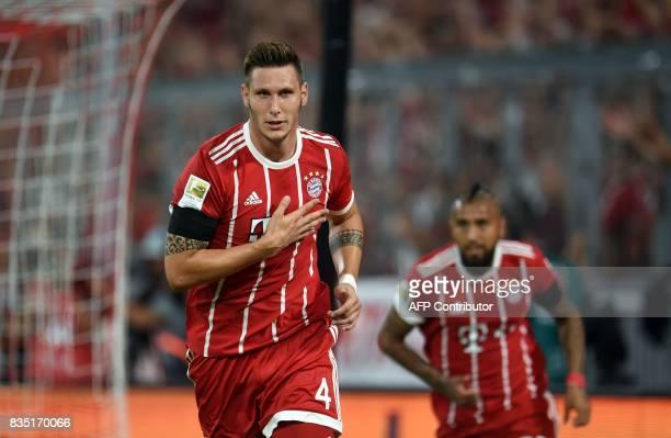 Bayern Munich's defender Niklas Suele celebrates scoring the opening goal of the season during the German First division Bundesliga football match FC...