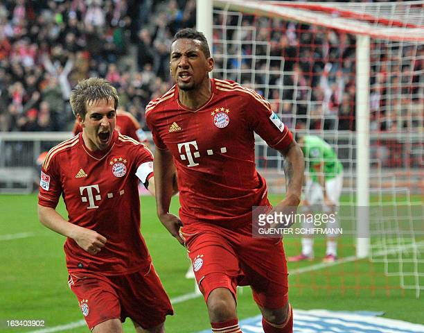 Bayern Munich's defender Philipp Lahm and Bayern Munich's defender Jerome Boateng celebrate scoring during the German first division Bundesliga...