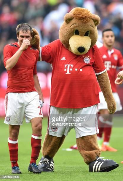 Bayern Munich's defender Philipp Lahm jokes with the Bayern Munich mascot after the German First division Bundesliga football match Bayern Munich vs...