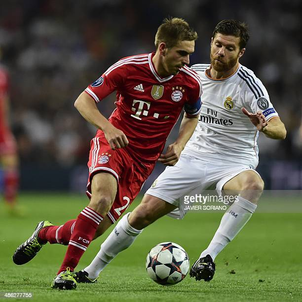Bayern Munich's defender Philipp Lahm vies with Real Madrid's midfielder Xabi Alonso during the UEFA Champions League semifinal first leg football...
