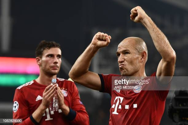 Bayern Munich's Dutch forward Arjen Robben celebrates their victory over Athens at the end of the UEFA Champions League football match between AEK...