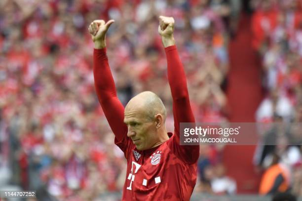 Bayern Munich's Dutch midfielder Arjen Robben acknoledges the cheers of fans for his last match with Bayern before the German First division...