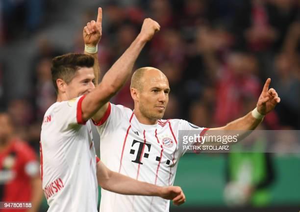 Bayern Munich's Dutch midfielder Arjen Robben and Bayern Munich's Polish forward Robert Lewandowski celebrate during the German football Cup DFB...